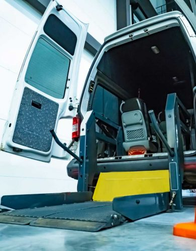 Disabled devices. Wheelchair lift mechanism. Machine equipped to transport a disabled person. Wheelchair lift into the bus.